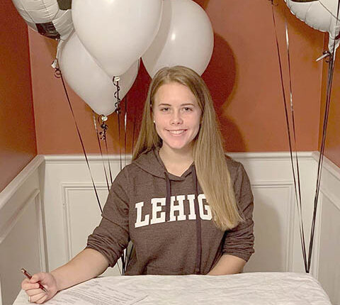 SPTS-11-26-OBS-Trainor-signs-her-D-I-NLI-to-Lehigh.jpg